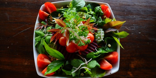 Green salad, cherry tomatoes, red beets and cucumbers